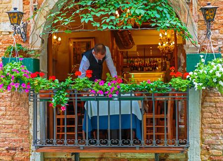 VENICE, ITALY - 26 JUNE, 2014: Street cafe in Venice Italy