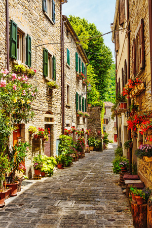 cobbled: Narrow street in the old town in Italy