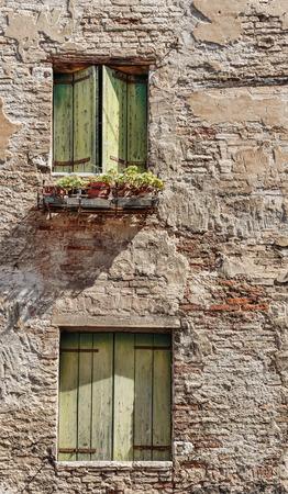 Facade of the old Italian house in Venice photo