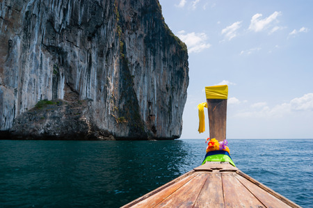 Traditional Thai Longtail boat and island of Phi Phi Leh on the horizon,Thailand photo