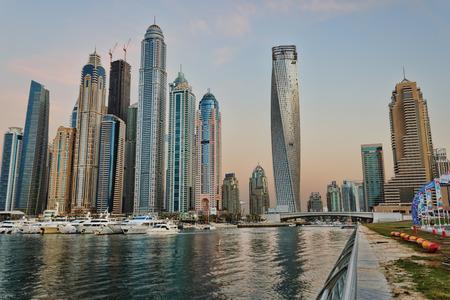 persian gulf: DUBAI, UAE - NOVEMBER 14: Dubai Marina at sunset, on November 14, 2012, Dubai, UAE. In the city of artificial channel length of 3 kilometers along the Persian Gulf.