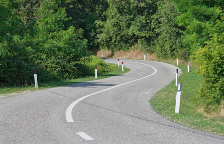 Winding road in the hills photo