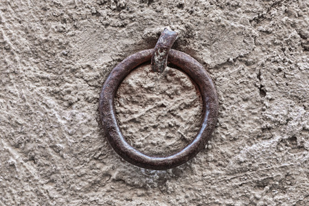 Old rusty ring on the stone wall photo