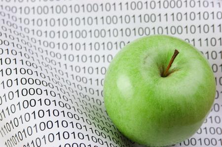 green apple on a binary code photo