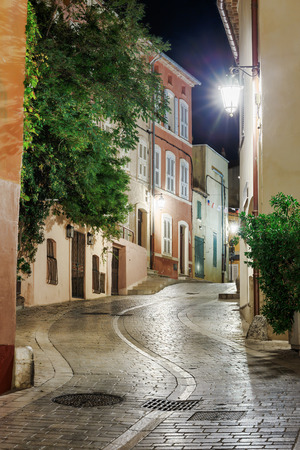 Narrow old street at night in Saint-Tropez, France. photo