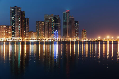 sharjah: SHARJAH, UAE - OCTOBER 29: Night view of Sharjah, on October 29, 2013. Sharjah is located along northern coast of Persian Gulf on Arabian Peninsula