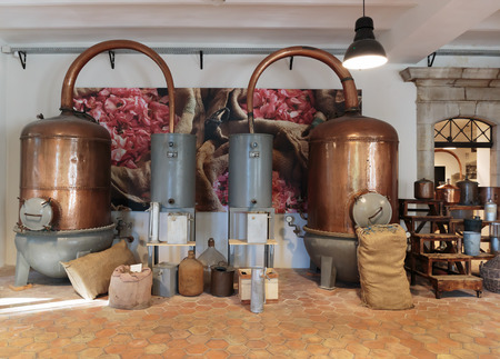 antique factory: GRASSE, FRANCE - OCTOBER 31, 2014: Ancient distiller for the production of perfume in Fragonard factory