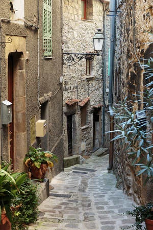 desolated: Narrow cobbled streets with flowers in the old village Gourdon, France