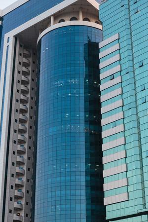 industrialized: SHARJAH, UAE - OCTOBER 29,  2013: Modern buildings in Sharjah. It is the most industrialized emirate in UAE. Editorial