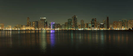 persian gulf: SHARJAH, UAE - NOVEMBER 01: Night view of Sharjah, on November 01, 2013. Sharjah is located along northern coast of Persian Gulf on Arabian Peninsula