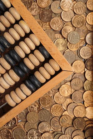 old wooden abacus on coins background photo