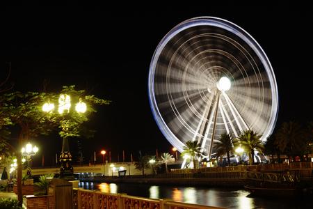 third wheel: SHARJAH, UAE - OCTOBER 29: Ferris wheel in Al Qasba. Sharjah - third largest and most populous city in United Arab Emirates, on October 29, 2013.