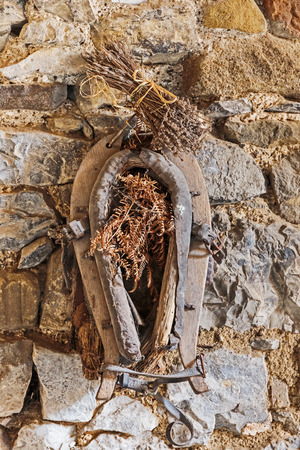 horse collar: Old horse collar on the stone wall