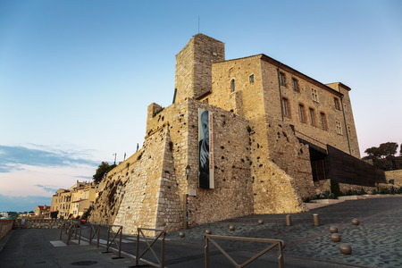 ANTIBES, FRANCE - NOVEMBER 3, 2014: Medieval fortress at dawn Antibes, France