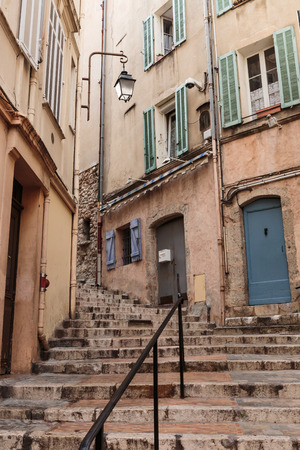 alpes maritimes: Narrow old street in the old town Cannes, France