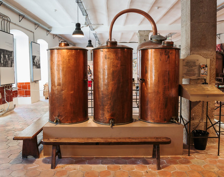 france perfume: GRASSE, FRANCE - OCTOBER 31, 2014: Ancient distiller for the production of perfume in Fragonard factory in Grasse Editorial