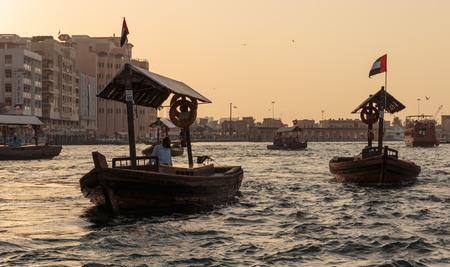 bur dubai: DUBAI, UAE-NOVEMBER 8, 2013: Ship in Port Saeed at sunset. The oldest commercial port of Dubai Editorial