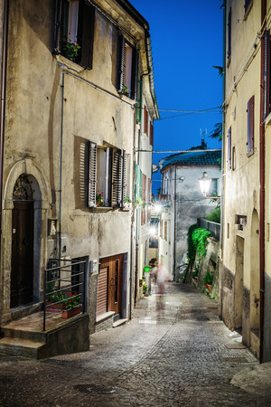 Street in the old town in Italy at night photo