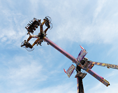 thrill: MONTE CARLO, MONACO - NOVEMBER 2, 2014: People wait up in the blue sky for the vertical ride and the zero gravity thrill at an amusement park