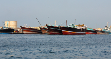 persian gulf: SHARJAH, UAE - OCTOBER 29: Sharjah port, on October 29, 2013. Sharjah is located along northern coast of Persian Gulf on Arabian Peninsula