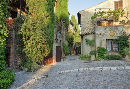 cobbled: Street with flowers in the old town  in France. Stock Photo