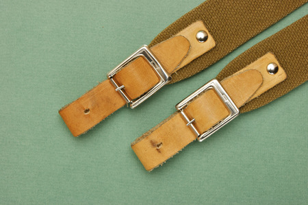 waistband: leather strap with a buckle on a green background