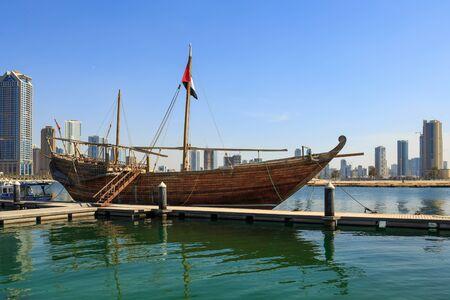 sharjah: SHARJAH, UAE - NOVEMBER 10, 2013: Old sailing ship at the pier