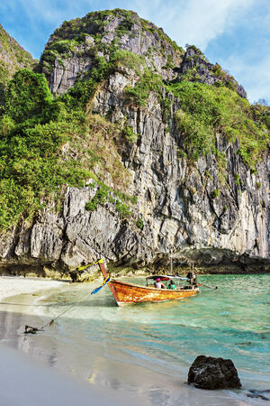 phi: Traditional Thai boat and island of Phi Phi Leh ,Thailand