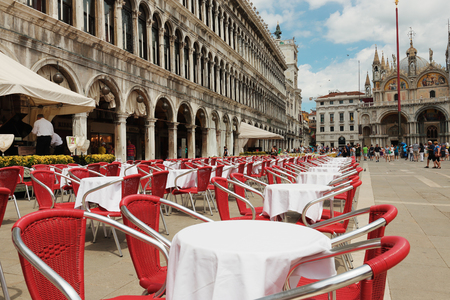 st  mark's square: VENICE, ITALY - 26 JUNE, 2014: Street cafe on the square San Marco Piazza (St. Marks Square) in Venice