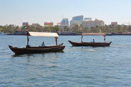 bur dubai: DUBAI, UAE-OCTOBER 30, 2013: Traditional Abra ferries. Shipbuilding technology is unchanged from the 18th century.