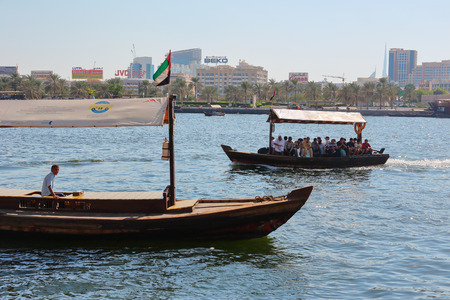 ferries: DUBAI, UAE-OCTOBER 30, 2013: Traditional Abra ferries. Shipbuilding technology is unchanged from the 18th century.