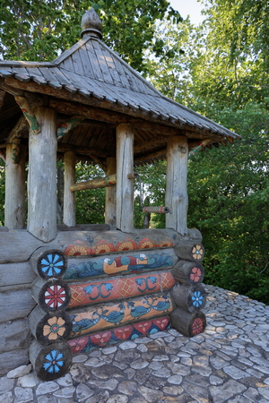 draw well: SAMARA, RUSSIA - 28 MAY, 2014: Heritage village, rustic wooden well