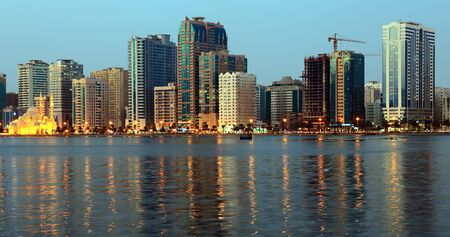 persian gulf: SHARJAH, UAE - OCTOBER 29, 2013: Night view of Sharjah, Sharjah is located along northern coast of Persian Gulf on Arabian Peninsula
