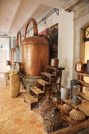 france perfume: Ancient distiller for the production of perfume in Fragonard factory in Grasse, France Editorial