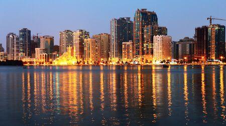 sharjah: SHARJAH, UAE - OCTOBER 29, 2013: Night view of Sharjah, Sharjah is located along northern coast of Persian Gulf on Arabian Peninsula