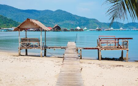 chang: Old wooden jetty on exotic beach Koh Chang island, Thailand Stock Photo