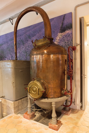 france perfume: Ancient distiller for the production of perfume in Fragonard factory in Grasse, France Stock Photo
