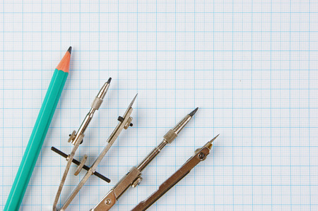 delineation: Old drawing tools on graph paper Stock Photo
