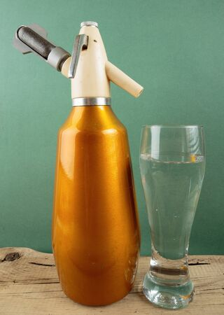 seltzer: Old vintage aluminum  siphon and glass of water