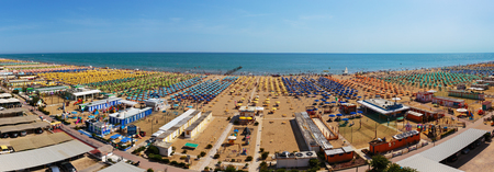 water s edge: RIMINI, ITALY - 24 JUNE, 2014: Public beach town on the Mediterranean Sea. Panorama Editorial