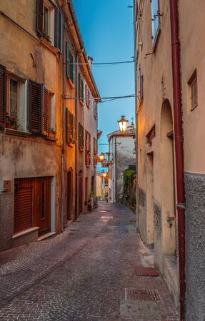 eventide: Narrow street in the old town at night in Italy Stock Photo