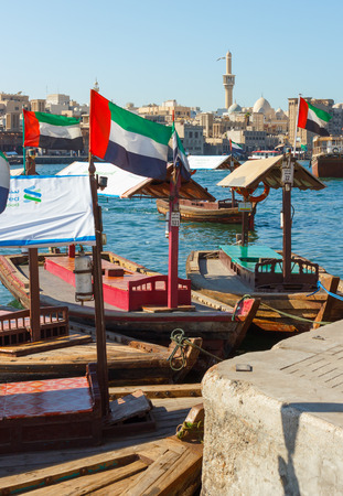 bur dubai: DUBAI, UAE-NOVEMBER 18, 2012: Traditional Abra ferries at the creek Editorial