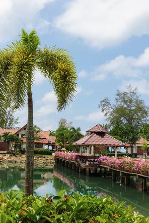 mart: KOH CHANG, THAILAND - 31 MART, 2015: Klong Prao Resort. Bridge with flowers across the bay in a tropical garden