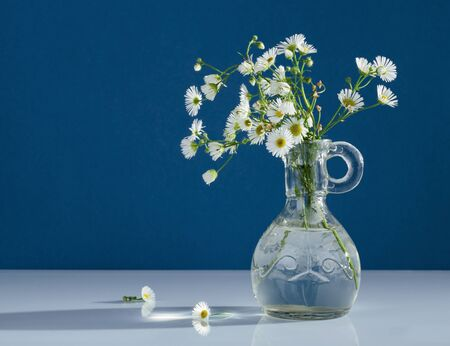 vases: Bouquet of wild flowers in a glass vase