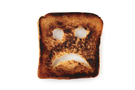 sad face: Sad toast isolated on white background
