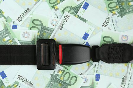 safety belt: safety belt on euro banknotes Stock Photo