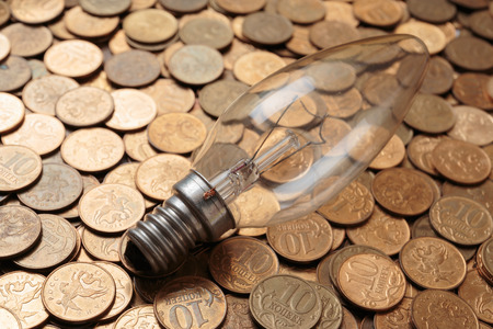 incandescent: incandescent lamp  on coins background