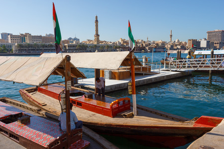bur dubai: DUBAI, UAE-NOVEMBER 18, 2012: Traditional Abra ferries at the creek Editorial