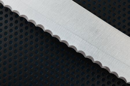 bread knife: Close up of the blade of stainless steel bread knife