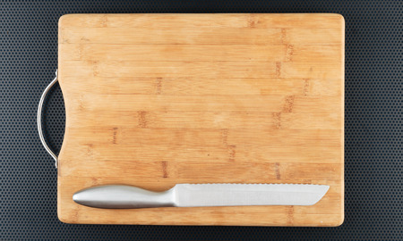 kitchen  cooking: Kitchen cutting board and knife on a metal table Stock Photo